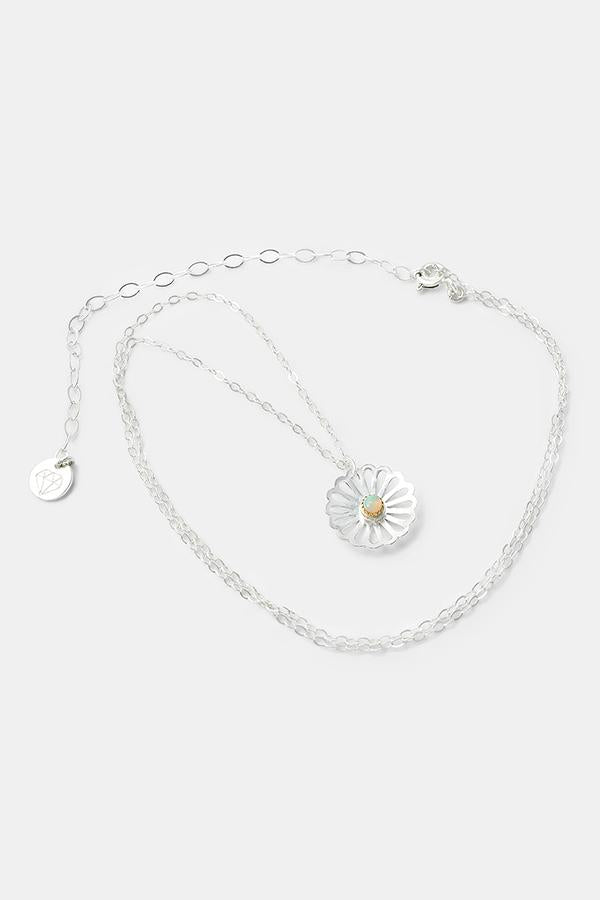 Daisy pendant necklace handmade in sterling silver with a solid gold opal gemstone setting. Created by artisan jewelry designer Simone Walsh.