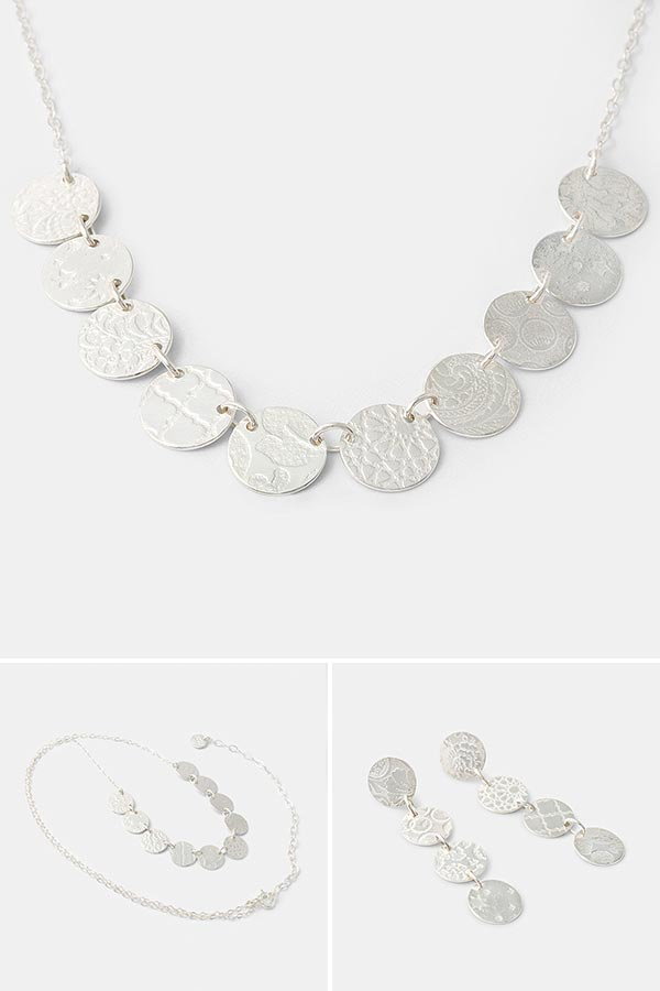 Unique handmade jewelry: handmade silver chain with patterned dots. Each necklace made is one of a kind jewelry. Handmade jewelry store online.