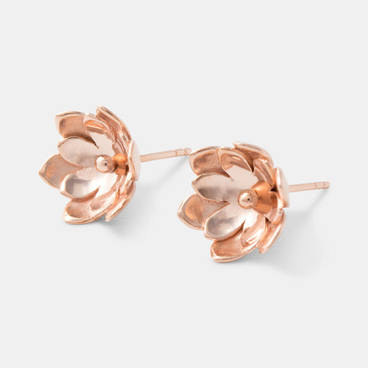 Rose gold stud earrings in a unique tulip design by handmade jewelry designer Simone Walsh.
