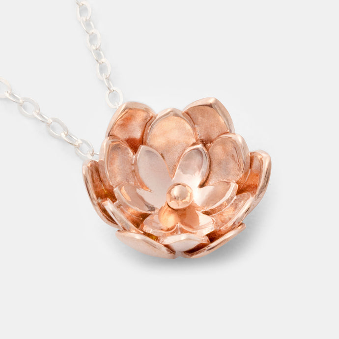 Rose gold pendant necklace with a tulip flower design created by handmade jewelry designer Simone Walsh.