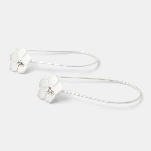 Sterling silver dangle earrings with forget-me-not flowers by handmade jewelry designer Simone Walsh.