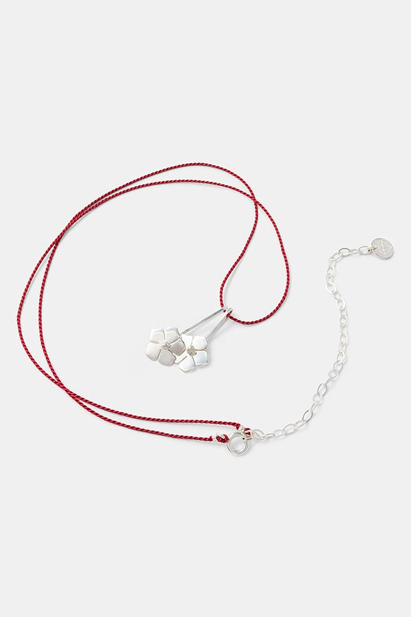 Unique handmade jewelry: forget me not flower necklace in sterling silver with red silk. Handmade designer jewelry store online.