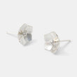 Sweetly simple sterling silver stud earrings with forget-me-not flowers by handmade jewelry designer Simone Walsh.
