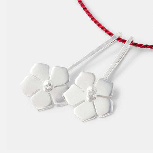 Sterling silver forget-me-nots pendants on red silk necklace by handmade jewelry designer Simone Walsh.