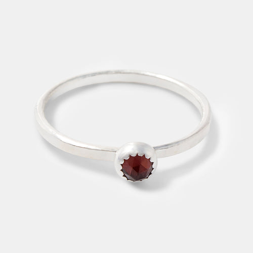 Unique sterling silver stacking ring with garnet gemstone by handcrafted jewelry designer Simone Walsh.