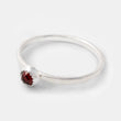 Garnet gemstone stacking ring in sterling silver. Handcrafted silver ring by handmade jewelry designer Simone Walsh.