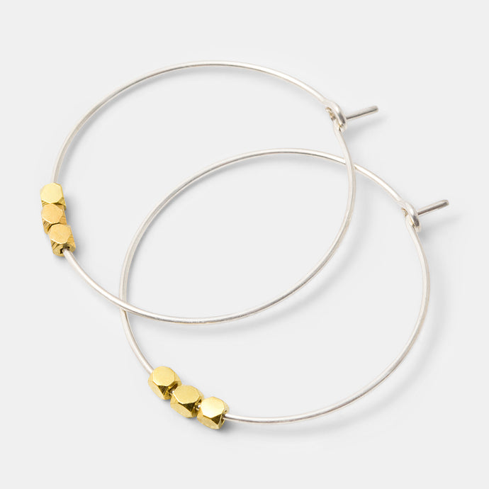 Simple sterling silver hoop earrings with gold cube beads in our handmade jewelry online store.