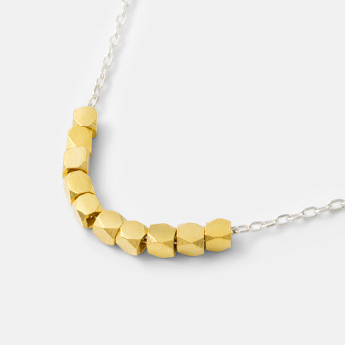 Sterling silver chain necklace with gold cubes in our handmade jewelry store.