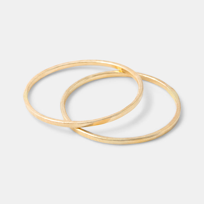 Simple handmade solid gold stacking rings handcrafted by handmade jewelry designer Simone Walsh.