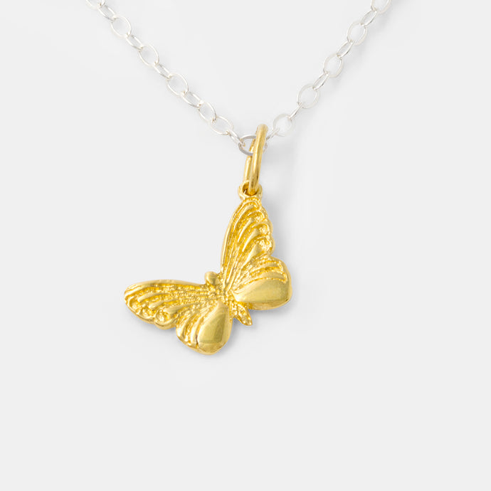 Gold butterfly pendant with sterling silver in our handmade jewelry store.