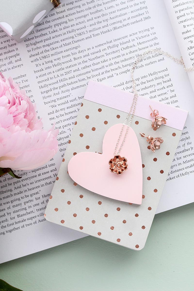 Beautiful rose gold wedding jewelry: unique bridal jewelry. Rose gold vermeil pendant necklace with matching earrings with a beautiful tulip design. Handmade jewelry store online.
