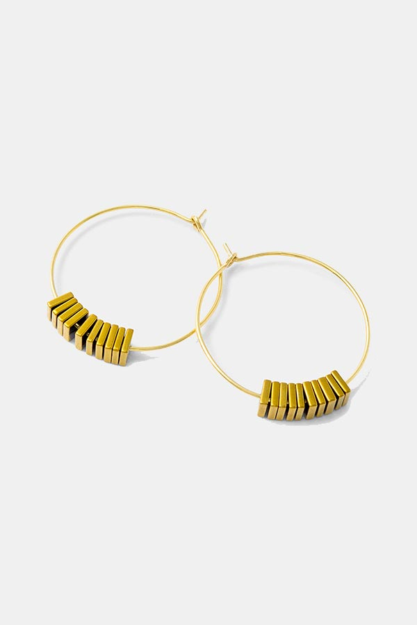 Gemstone gold hoop earrings. Hematine gemstones in a contemporary jewelry design. Gold jewelry.