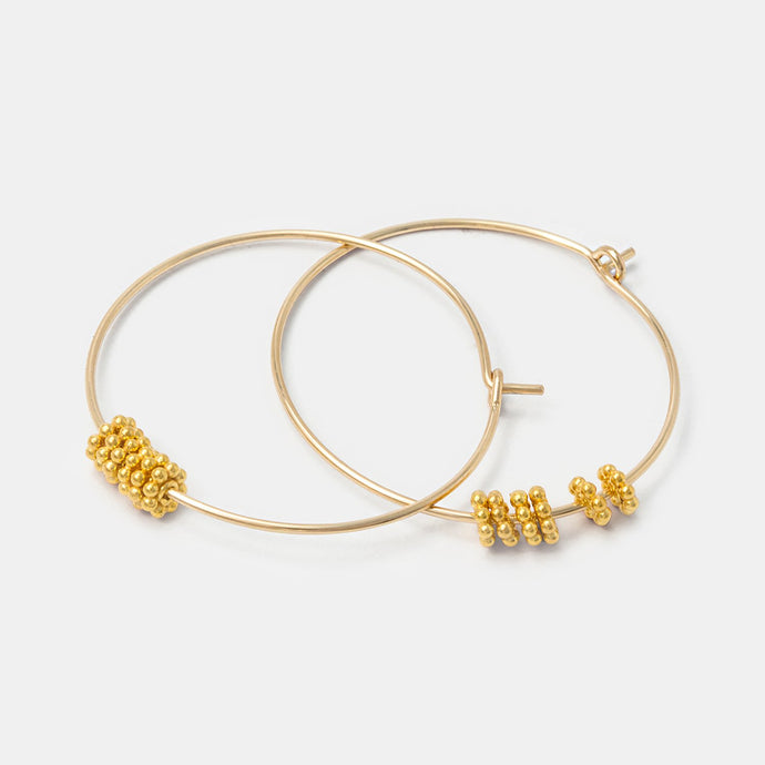 Gold dotted bead hoop earrings
