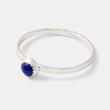 Handmade sterling silver stacking ring with a lapis lazuli gemstone setting in our handmade jewelry store online.
