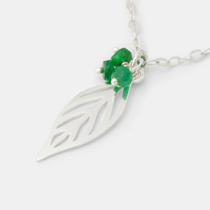Leaf pendant with emeralds
