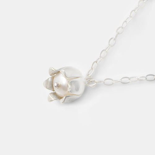 Beautiful pearl and sterling silver pendant necklace with a lily of the valley flower by handmade jewelry designer Simone Walsh.