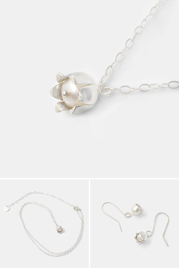 Beautiful silver necklace for women: lily of the valley flower pendant necklace in sterling silver with a cultured pearl. Unique handmade designer jewelry. Shop online.