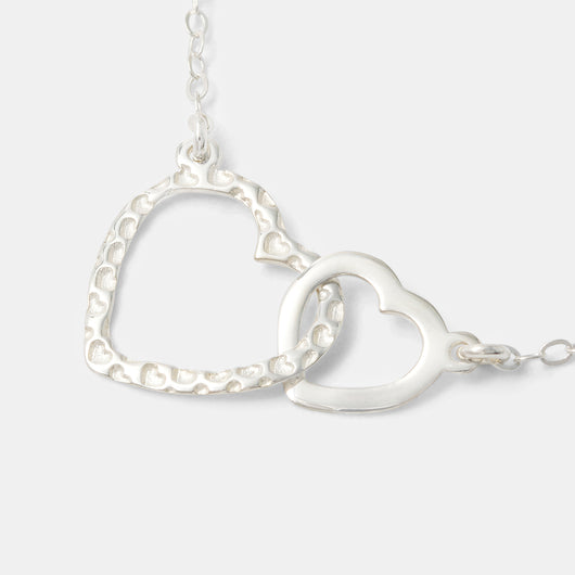 Unique heart necklace in sterling silver by handmade jewelry designer Simone Walsh.