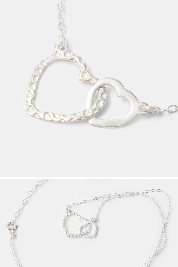 Love hearts necklace in sterling silver. Beautiful handmade silver jewelry for women in our handmade jewelry store online.