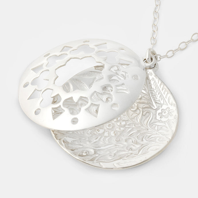 Sterling silver open locket pendant necklace: statement jewelry by handcrafted jewelry designer Simone Walsh.