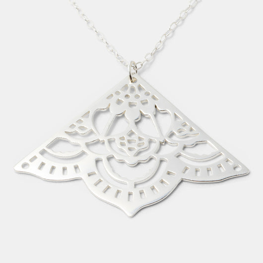 Handmade silver pendant necklace for women with a mehndi mandala design by handmade jewelry designer Simone Walsh.