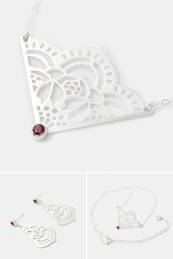 Unique handmade silver jewelry: mehndi pendant necklace in sterling silver with a rhodolite gemstone. Unique bridal jewelry and beautiful jewelry to dress up with. Unique handmade silver jewelry online store.
