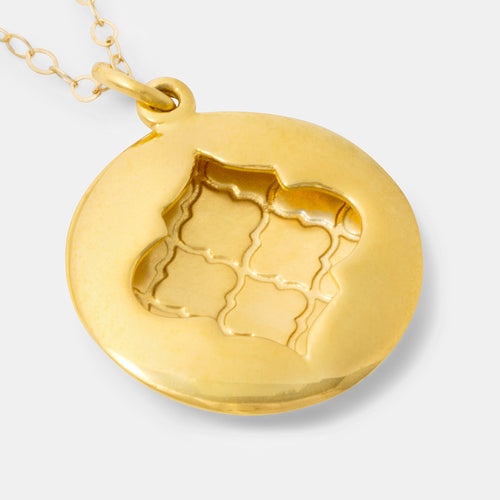 Handmade gold pendant necklace with a Moroccan tile design by handmade jewelry designer Simone Walsh.