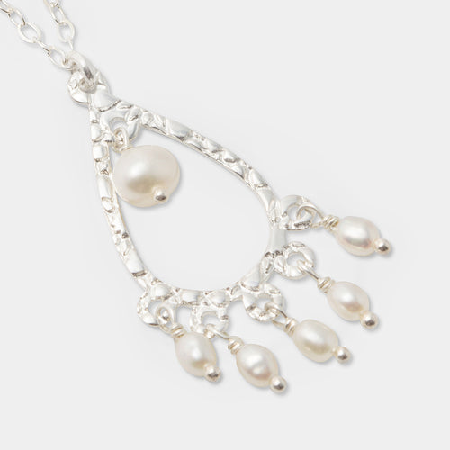 Handmade sterling silver and pearls pendant necklace with a chandelier design by handmade jewelry designer Simone Walsh.