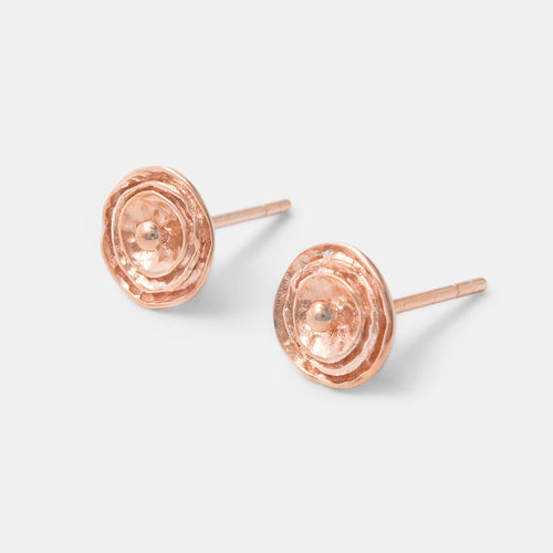 Handmade rose gold stud earrings in a contemporary rose design by handmade jewelry designer Simone Walsh.