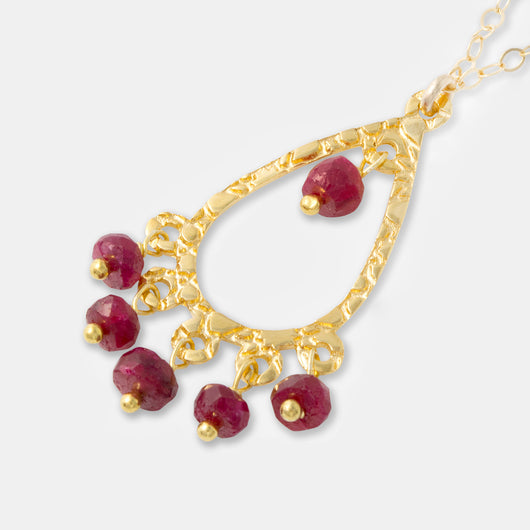 Handcrafted jewelry: ruby and gold chandelier pendant necklace by handmade jewelry designer Simone Walsh.