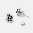 Handmade stud earrings in sterling silver with a unique rose design in our handmade jewelry online store.