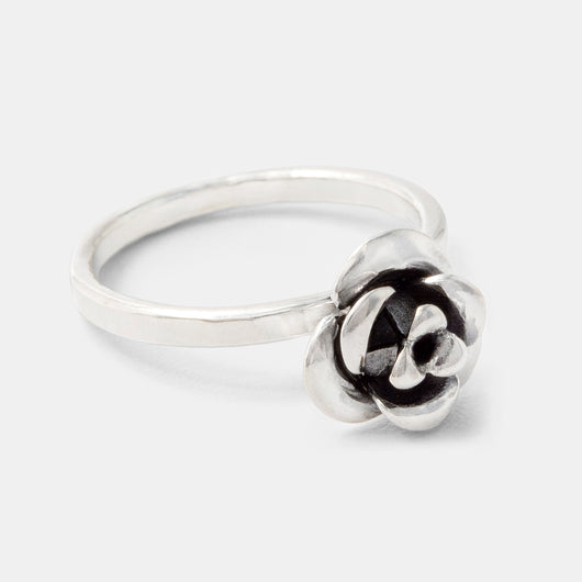 Handcrafted jewelry: sterling silver cocktail ring with a unique rose design by handmade jewelry designer Simone Walsh.