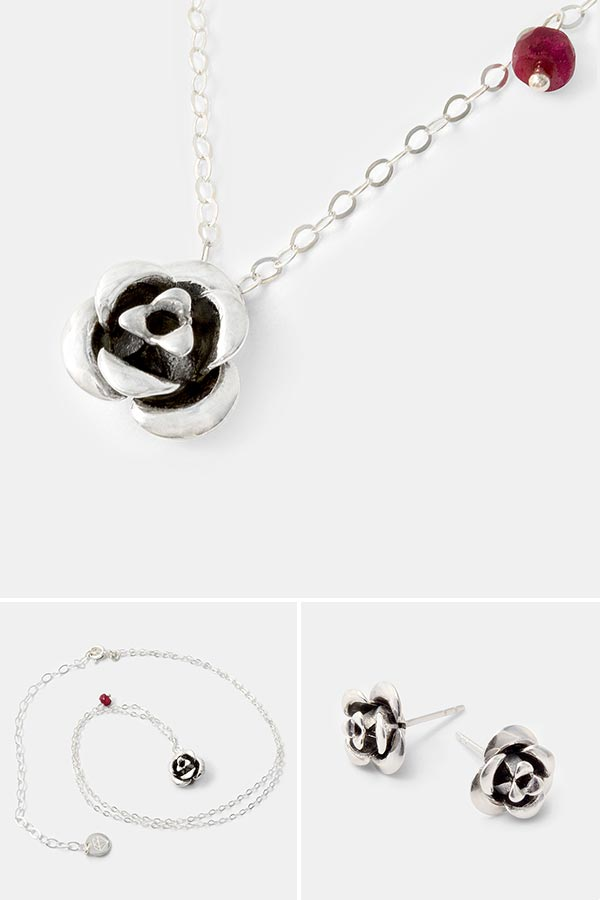 Beautiful everyday jewelry: unique handmade silver necklace with a silver rose pendant and ruby gemstone. Handmade jewelry store online.