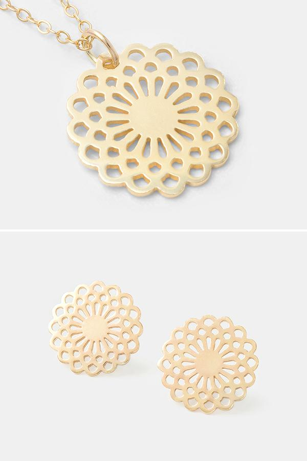 Solid gold jewellery: 14k gold stud earrings and pendant necklace with a dahlia flower design. By Australian jewellery designer Simone Walsh.
