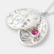 Beautiful handmade silver pendant necklace: unique open locket design in sterling silver with a ruby gemstone in our handmade jewelry store.
