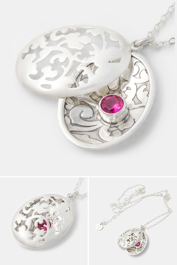 Unique handmade statement jewelry: Victorian open locket necklace in sterling silver with a partly hidden ruby gemstone. Handmade silver jewelry in our handmade jewelry store.
