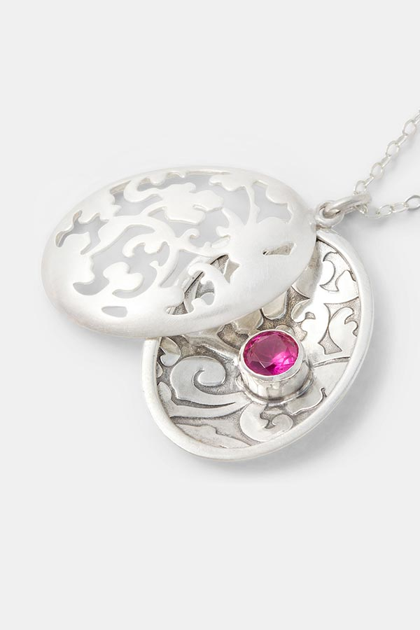 Beautiful jewelry: unique silver jewelry in an open locket necklace design. Intricate jewelry with a Victorian inspired pattern. Handmade silver jewelry in our handmade jewelry store.
