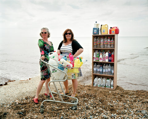 Photo of women cleaning up plastic on the beach by Amanda Jackson