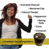 Woman jumping for joy with natural ingredients of activated charcoal, bentonite clay, calcium powder, peppermint, baking soda, clove and cinnamon.