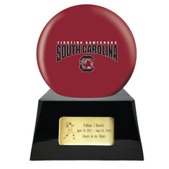 Image of Football Cremation Urn with Optional South Carolina Gamecocks Ball Decor and Custom Metal Plaque
