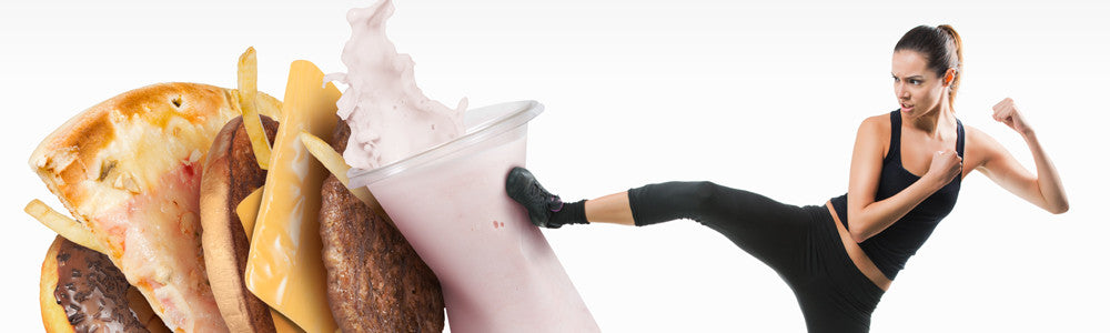 Healthy Woman kicking a smoothie to move junk food aside
