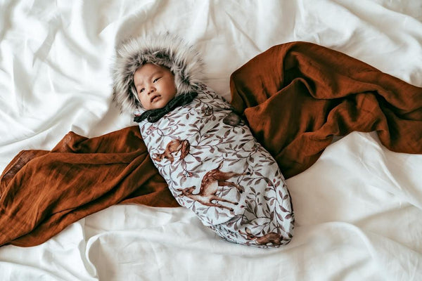 Creatures of the Woods Swaddle  on baby