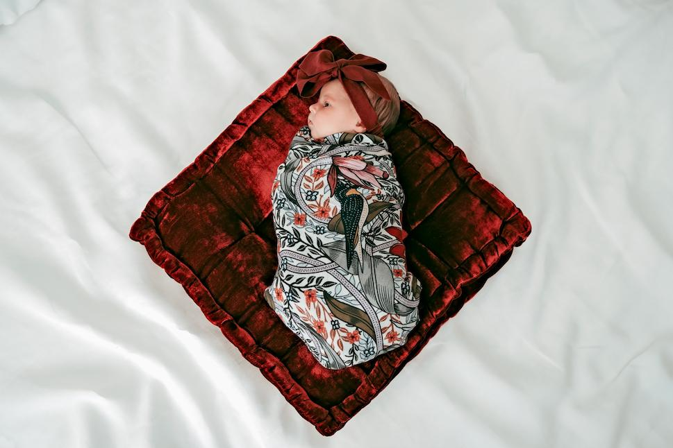 Nouveau in Flight Swaddle on baby