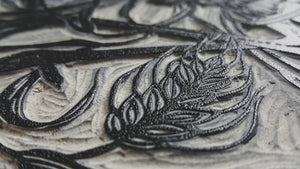 Closeup of an inked up linocut printing block.