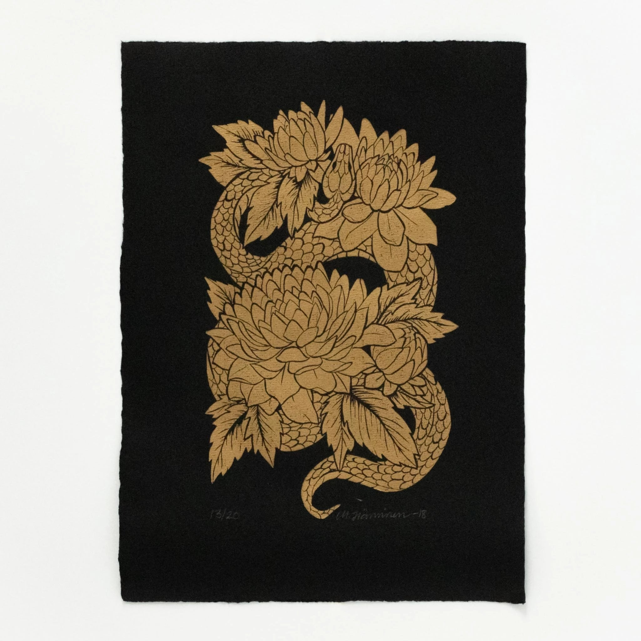 Old-school tattoo flash style linocut art print of a golden snake and dahlia flowers in full bloom on black A4 paper.