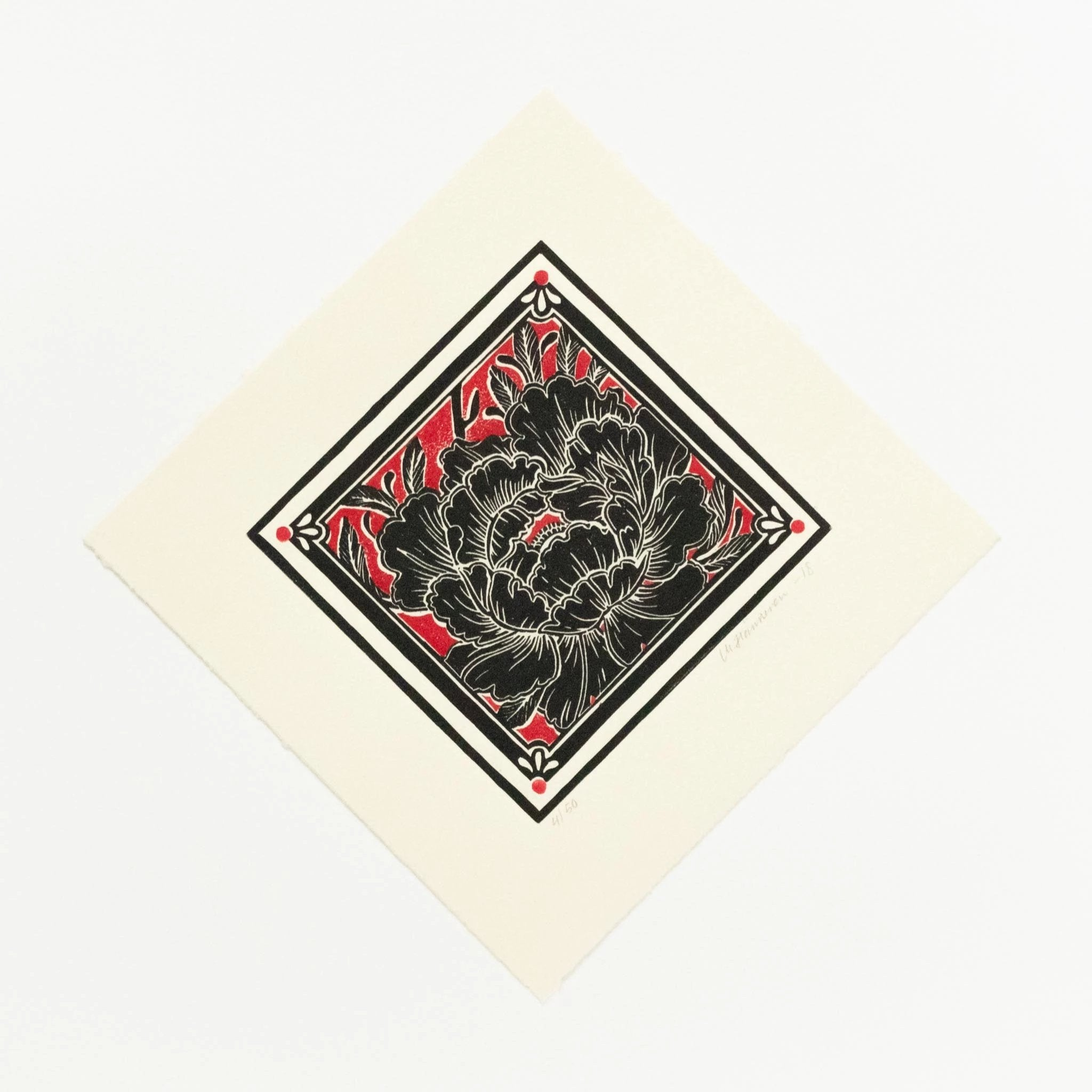 Japanese block print inspired linocut of a single black peony with crimson red background, on diamond shape, tea dyed paper.
