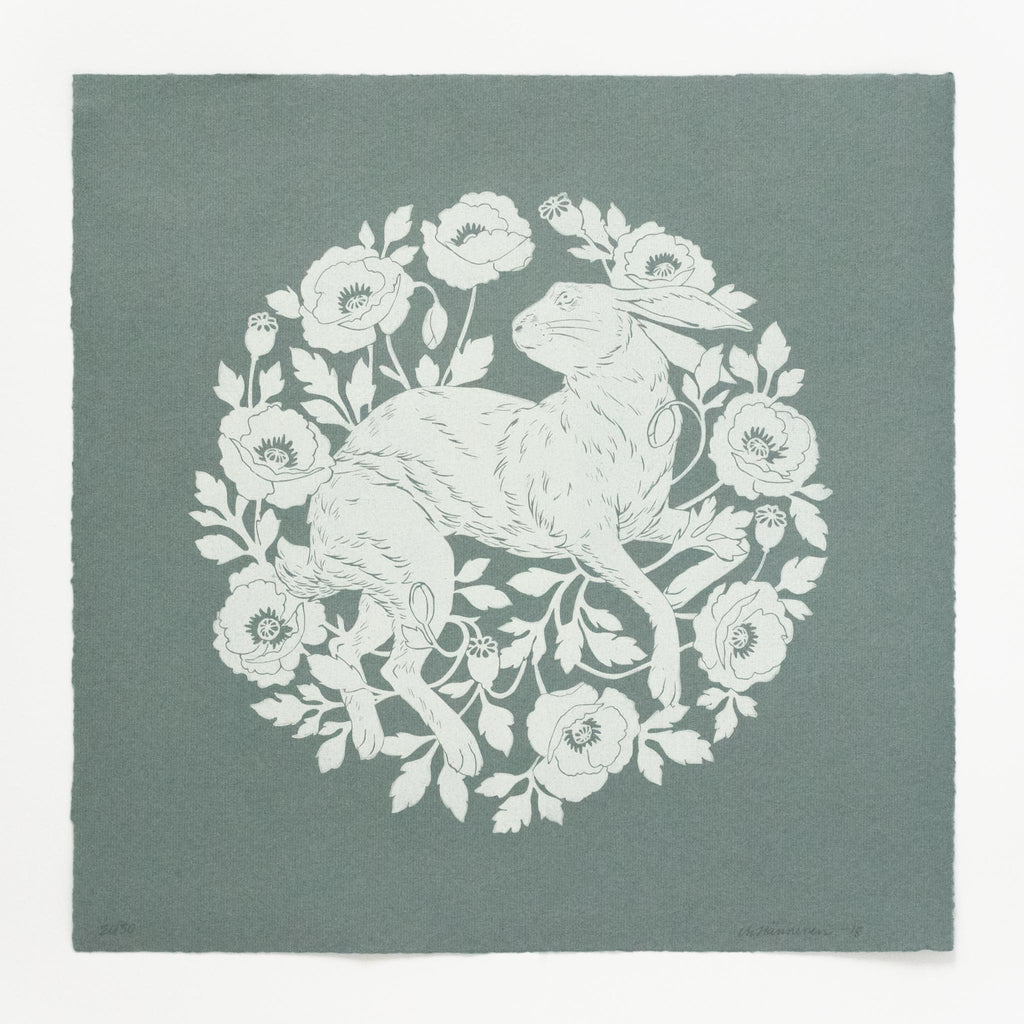 Decorative, circular linocut print of a hare and poppies, hand-printed in white ink on square, blue-grey ingres paper.
