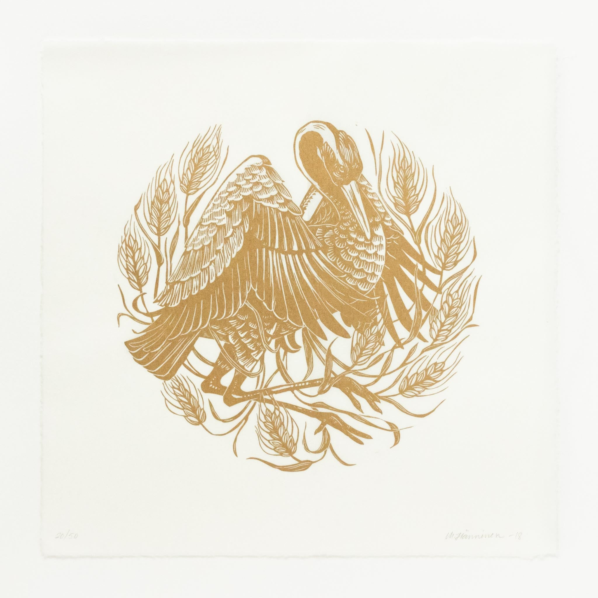 Round linocut design of a crane with wings open in a field of grain, printed with gold ink on square white Japanese paper.