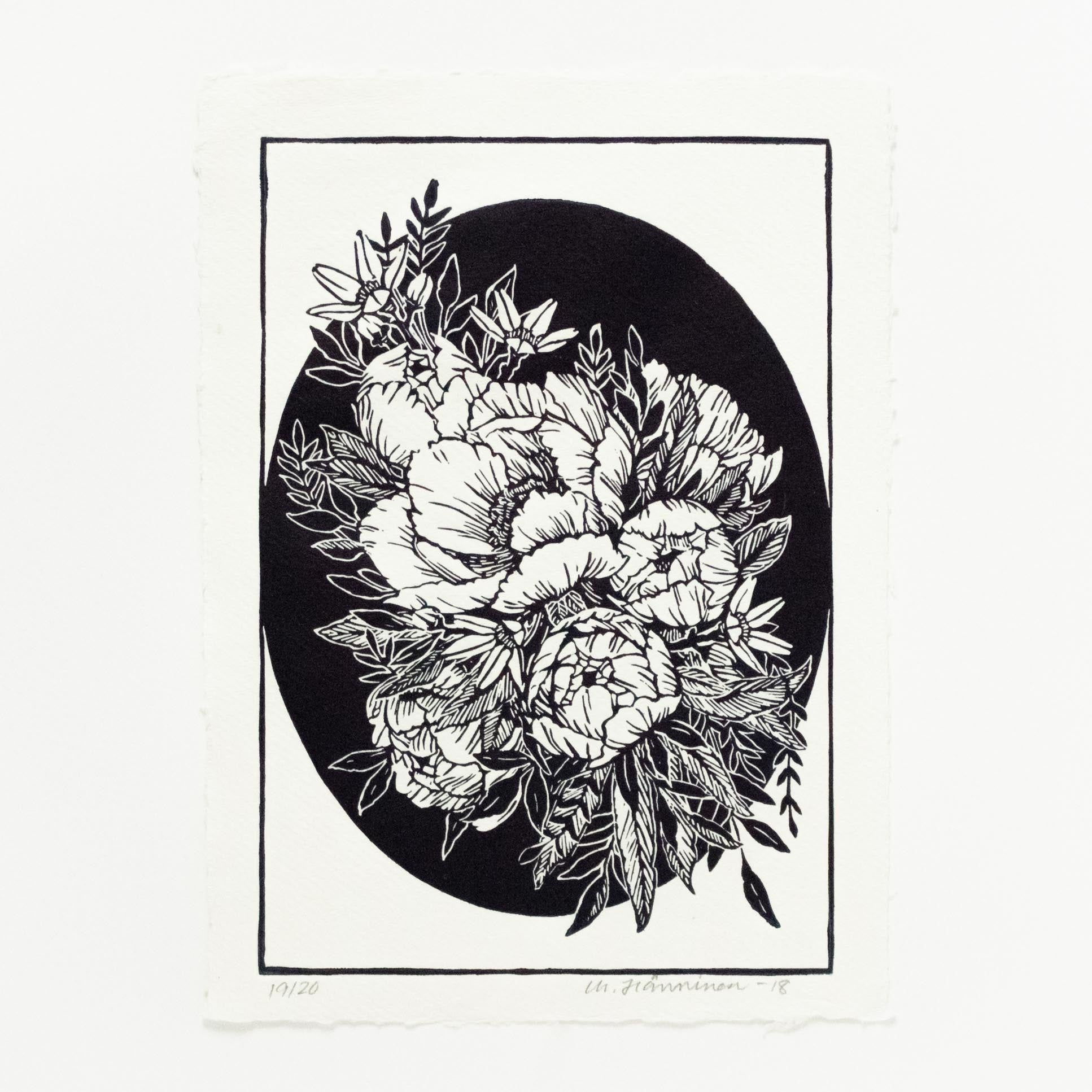 A floral linocut print of bucket of peonies and oval shaped background, printed in dark blue on white A4 cotton rag paper.