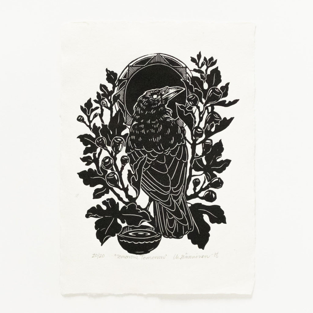 Linocut print of a raven perched in fig tree with black sun in background, printed with black ink on white cotton rag paper.